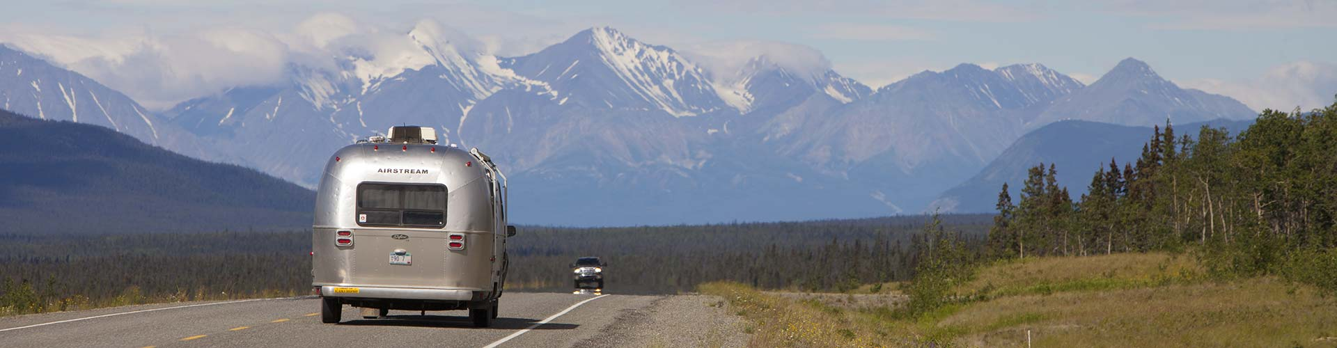 Alaska Highway with scenic Mountain Vista in backdrop